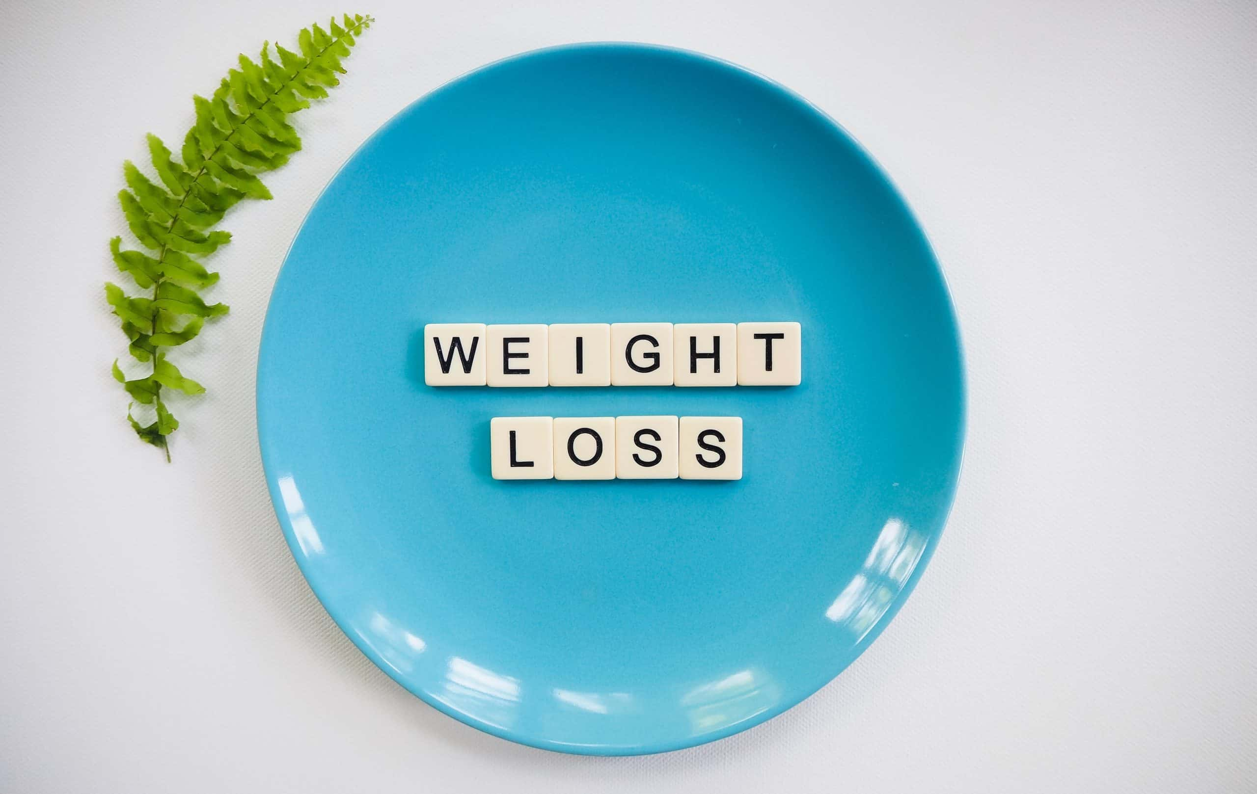 blue plate with white and black letters spelling Weight Loss.